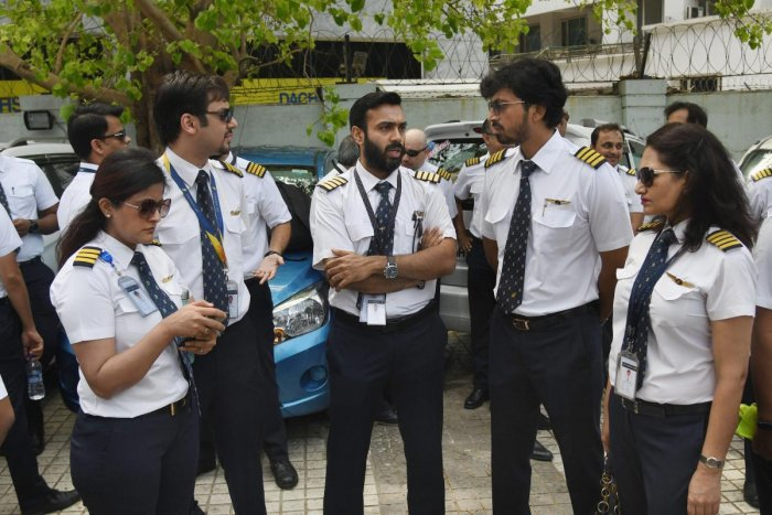 Jet Airways pilots and engineers assemble outside the Jet headquarters to express solidarity with the management and to request lenders to release the funds, in Mumbai, Monday April 15, 2019.The airline is operating just 6-7 planes, with almost its entire fleet being grounded due to non-payment of rentals to lessors amid severe paucity of cash. PTI