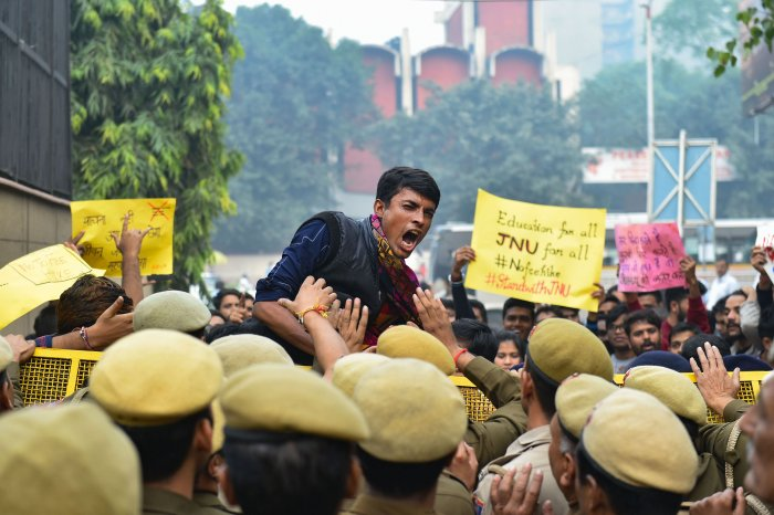 Police stop JNU students who were staging a protest over the hostel fee hike outside the UGC office at ITO in New Delhi. (PTI Photo)