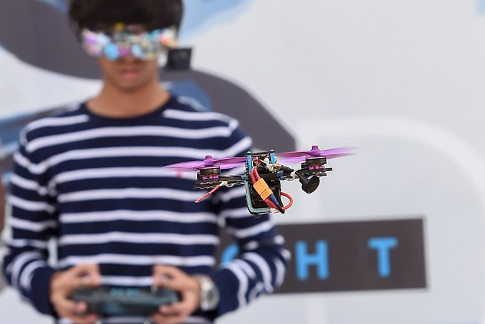 A drone pilot operates his drone during a practice session for the Night Drone Competition at the Bengaluru Tech Summit 2018, in Bengaluru. (PTI Photo)