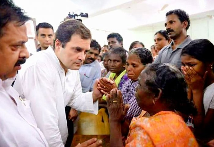 Rahul Gandhi interacts with the flood victims in Chengannur, Alappurzha, Kerala on Tuesday. (Photo credit: Twitter/@INCIndia)