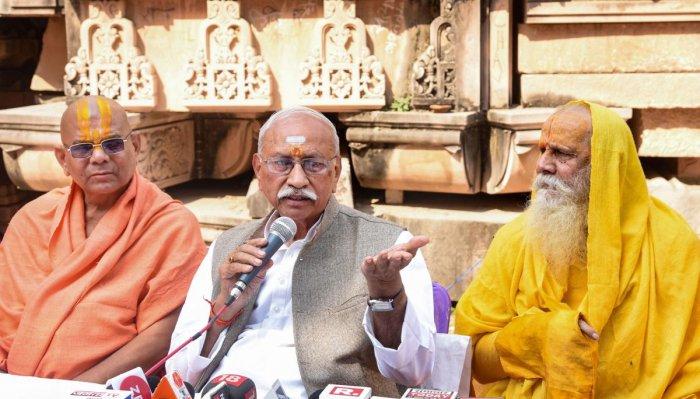 VHP leader Dinesh Ji (C) addresses a press conference at Ramjanmbhoomi Nyas Karyashala in Ayodhya on Wednesday. (PTI Photo)