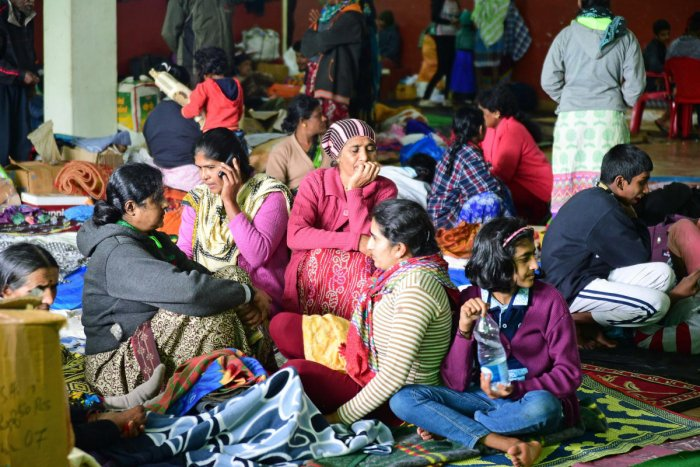 Flood-hit people are at their wit's end at a relief camp in Madikeri on Monday. dh photo