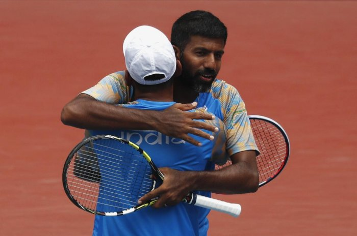 Rohan Bopanna and Divij Sharan of India celebrate after winning the Asian Games doubles gold against Aleksandr Bublik and Denis Yevseyev of Kazakhstan.