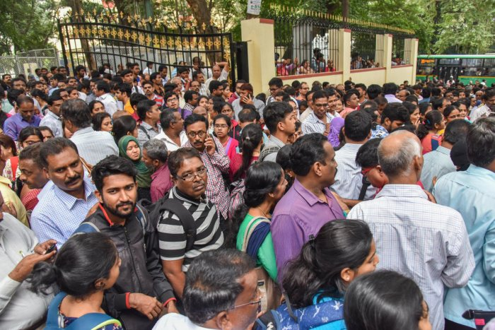 Anxious students and parents outside the KEA office on Friday. DH PHOTO/S K DINESH