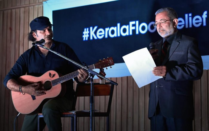 """Supreme Court judge Justice Kurian Joseph and singer Mohit Chauhan perform during an event to contribute to the """"Kerala flood relief fund"""", in New Delhi on Monday. PTI"""