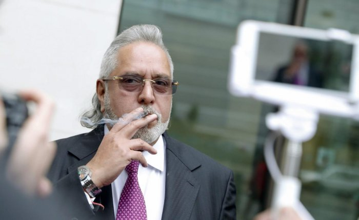 London : F1 Force India team boss Vijay Mallya smokes a cigarette outside Westminster Magistrates Court during a break for lunch as he attends a hearing at the court in London, Wednesday, Sept. 12, 2018. Mallya, once a leading figure among India's busines
