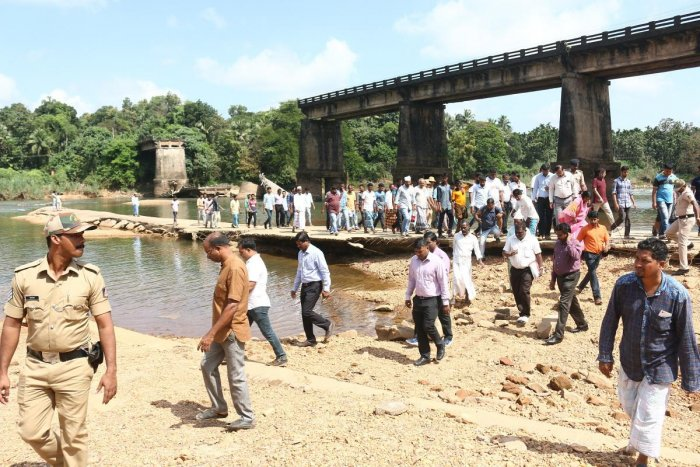 The inter-ministerial Central team inspects the collapsed Moolarapatna bridge on Thursday.