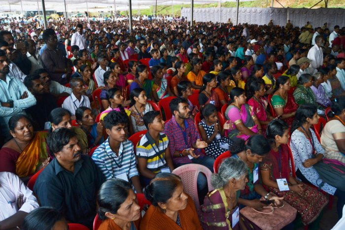 Flood victims take part in an interaction with Chief Minister H D Kumaraswamy in Madikeri on Wednesday.