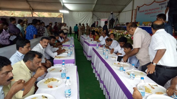 Chief Minister H D Kumaraswamy having lunch with flood victims in Madikeri.