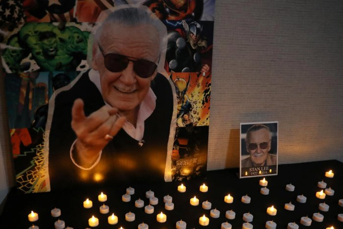 Photographs of comic book icon Stan Lee, who passed away at the age of 95 on November 12, 2018, are seen during a tribute in Stony Brook, New York on November 15, 2018. (REUTERS)