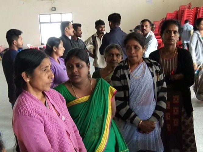 Victims who were taking shelter at the Maitri relief centre in Madikeri stage a flash protest on Monday, opposing the move of the district administration to vacate them from the hall.