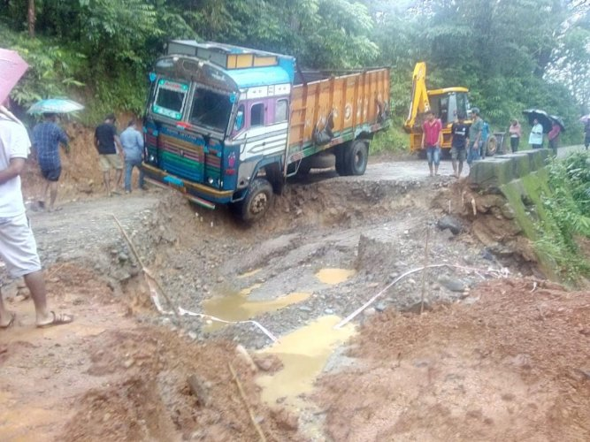 A truck stuck due to landslide in Meghalaya hills on Wednesday.