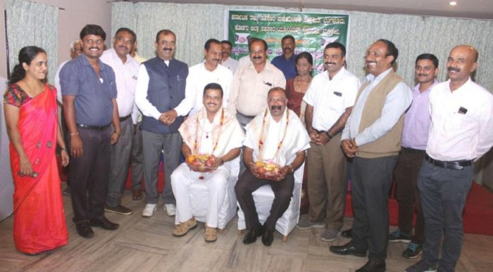 State Cooperative Federation president N Ganganna and DCC Bank president Ganapathy were felicitated during a state-level workshop in Madikeri on Thursday.
