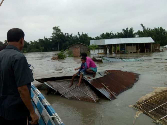Flood hit people being rescued in Assam on Saturday. DH photo