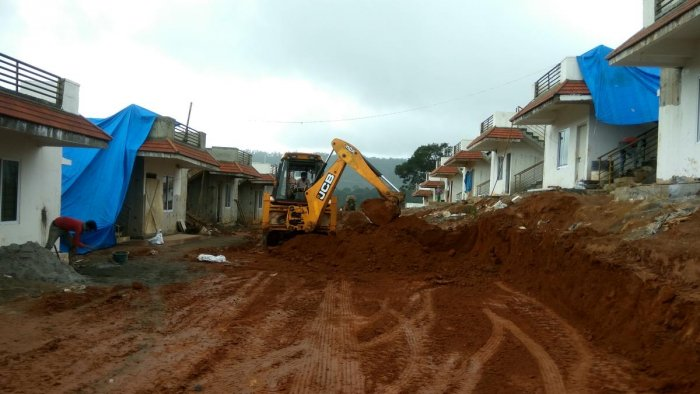 An excavator works on road construction at a group housing site in Made, near Madikeri.DH Photo/chiranjeevi kulkarni
