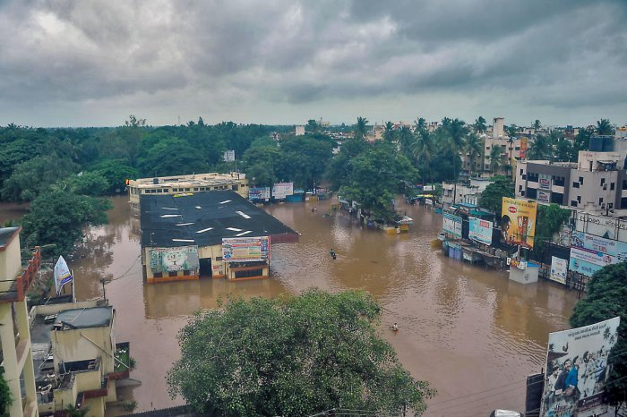 A view of flooded areas due to overflowing Krishna river during monsoon season, in Sangli on Wednesday. (PTI Photo)