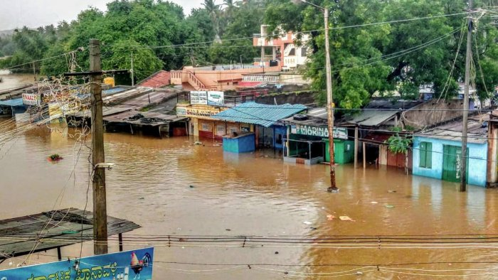 A view of Malaprabha river water flooding the Munavalli village after heavy rain, in Belgavi, Wednesday, Aug 7, 2019. (PTI Photo)