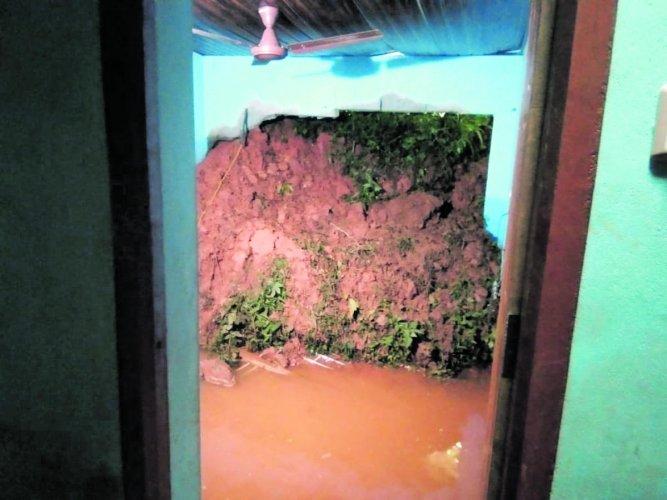 Soil from landslide has entered a house at Nandikadu.