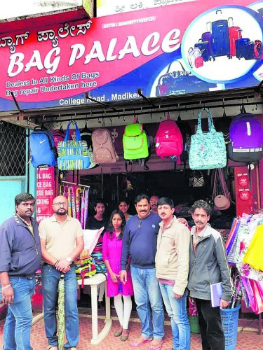 Madikeri Hitharakshana Vedike members with Bag Palace owner E J Peter (third from right).
