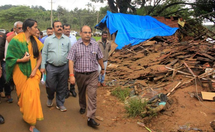 Deputy Commissioner Annies Kanmani Joy takes the Central team on a tour of the flood-affected area in Karadigodu village near Siddapura in Kodagu district on Tuesday.