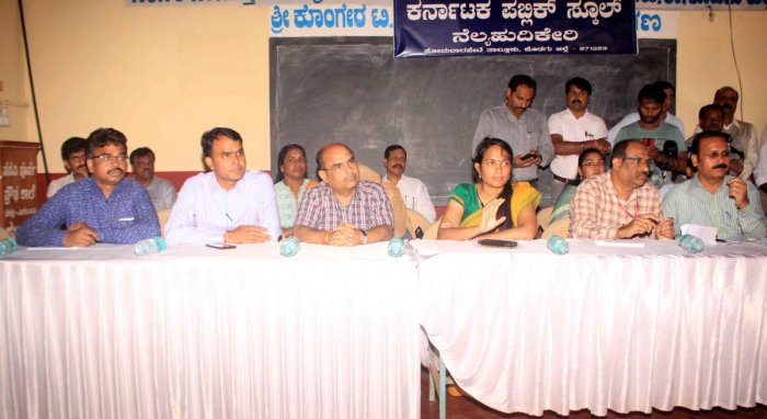 The Central team members who visited Kodagu on Tuesday to study the flood situation in the district. They interacted with the flood victims at the relief centre in Nelyahudikeri.