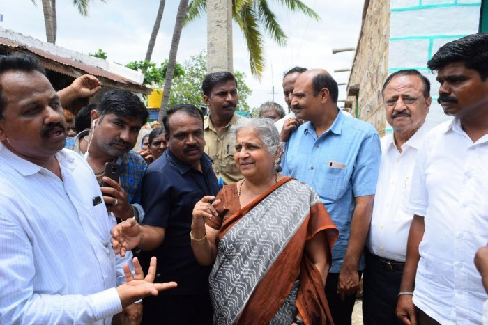 Infosys Foundation chairperson Sudha Murty interacts with the flood-affected at Konnur village in Nargund taluk of Gadag district on Friday.