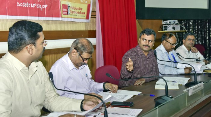 Zilla Panchayat CEO Dr R Selvamani chairs the district-level review committee and district consultative committee meeting at the Netravati Hall of the Zilla Panchayat in Mangaluru on Wednesday.
