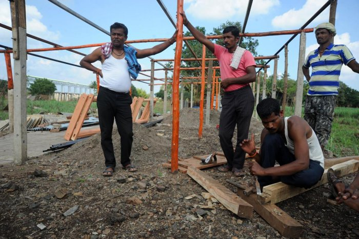 Residents of Janawad village in Belagavi district rebuild their houses which were washed away in the August floods. They continue to build their house very close to the barrage. | DH Photo: Pushkar V