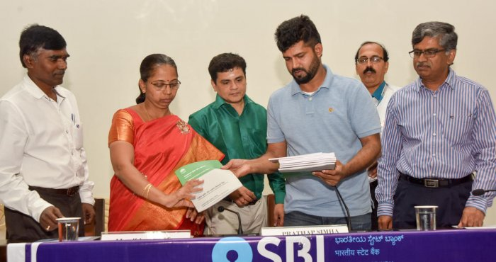 MP Pratap Simha releases Potential Linker Credit Plan 2020-21 during the quarterly progress review meeting, at Zilla Panchayat auditorium in Mysuru on Wednesday. Lead Bank Manager Venkatachalapathy and ZP CEO, also in-charge Deputy Commissioner, K Jyothi