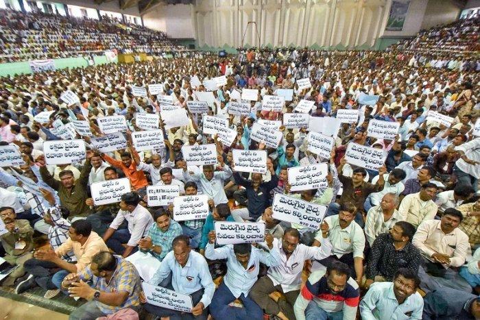 People attend rally Sakalajanula Samara Bheri by TSRTC employees unions' leader Aswathama Reddy at Saroor Nagar Indoor Stadium in Hyderabad. (PTI Photo)