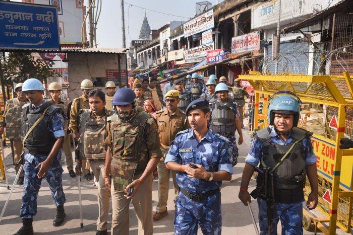 Police and RAF personnel patrol near the Hanumagarhi temple in Ayodhya. (PTI Photo)