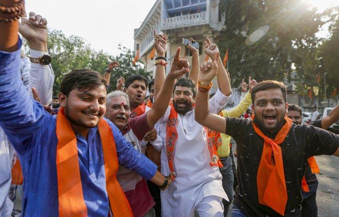 Vishva Hindu Parishad (VHP) celebrate after Supreme Court's verdict on Ayodhya land case, outside VHP office in Ahmedabad. (PTI Photo)