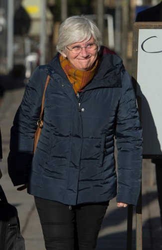 Former Catalan education minister Clara Ponsati arrives to hand herself in at a police station in Edinburgh. AFP