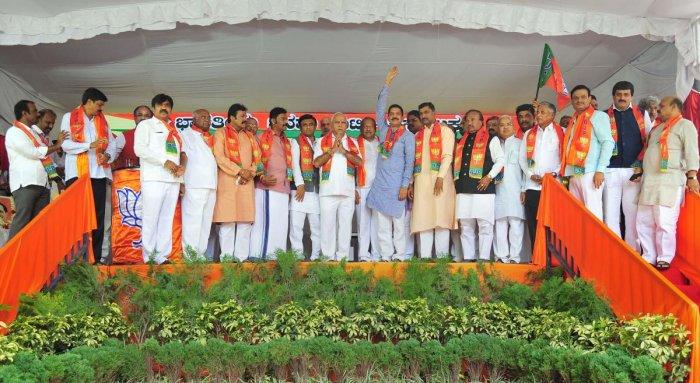 Karnataka Chief Minister B S Yediyurappa, BJP State Unit President Nalin Kumar Kateel and BJP National general secretary Muralidhar Rao with disqualified MLAs. PTI