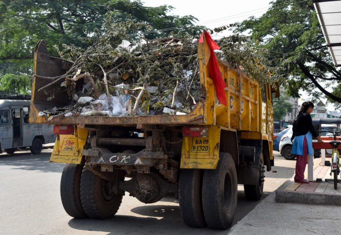 Unclear garbage and vehicles are is seen, near MCC office in Mysuru on Thursday. - PHOTO / SAVITHA B R