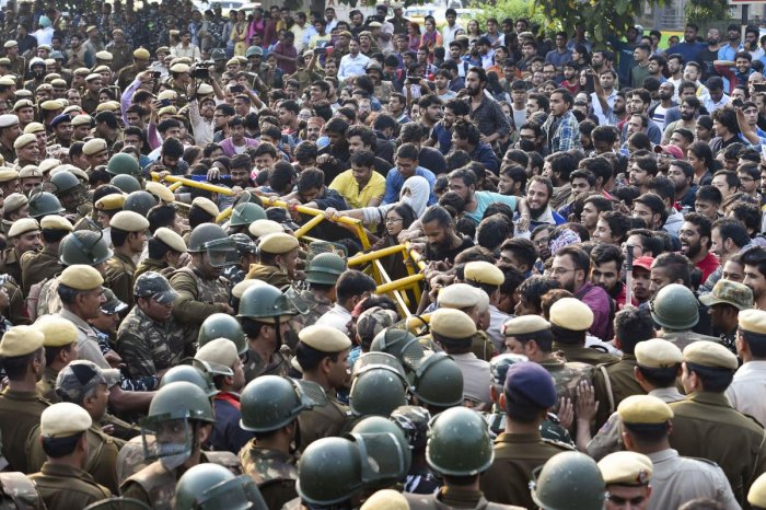 Police stop Jawaharlal Nehru University (JNU) students who were staging a protest over the hostel-fee hike and the administration's alleged 'anti-students' policy, in New Delhi.
