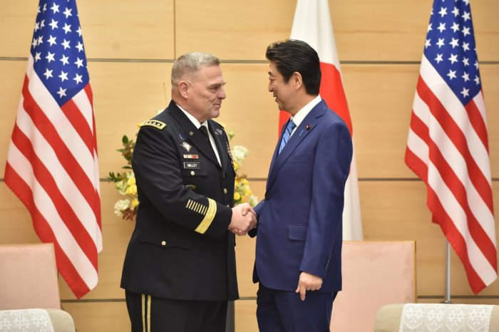 Japan's Prime Minister Shinzo Abe shakes hands with US Chairman of the Joint Chiefs of Staff Gen. Mark Milley. Representative Image. (AFP Photo)