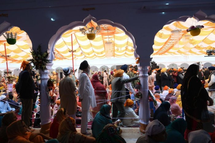 Sikh pilgrims take part in a religious ritual as they gather to celebrate the 550th birth anniversary of Guru Nanak Dev.