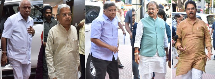 Chief Minister B S Yediyurappa, his deputy Govind M Karjol, Large and Medium Scale Industries Minister Jagadish Shettar, former minister Arvind Limbavali and Revenue Minister R Ashoka arrive for BJP core committee meeting at the party office in Bengaluru