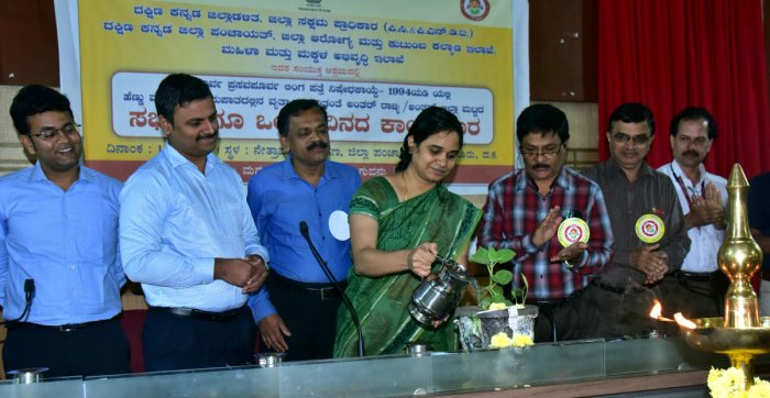 Deputy Commissioner Sindhu B Roopesh inaugurates a workshop on Pre-conception and Pre-natal Diagnostic Techniques Act by watering a plant at the Zilla Panchayat auditorium in Mangaluru on Wednesday.