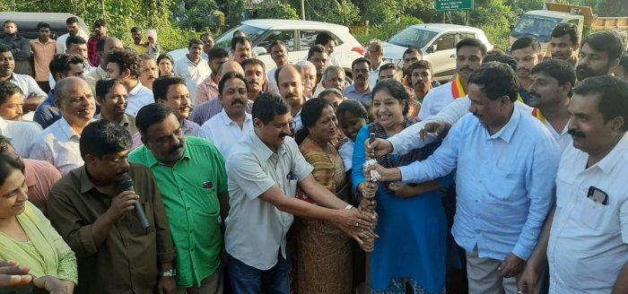 Virajpet MLA K G Bopaiah performs the ground-breaking ceremony for the widening of Ammatti-Meenupete Road on Wednesday.