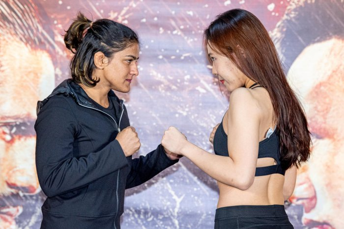 India's Ritu Phogat and South Korea's Kim Nam-hee face off in Beijing. (Photo by Reuters)
