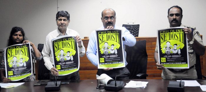 Udupi Additional Deputy Commissioner (ADC) Sadashiv Prabhu (second from right) and others release posters to create awareness on the week-long campaign 'Child Helpline Se Dosti' in Udupi on Wednesday. DH photo