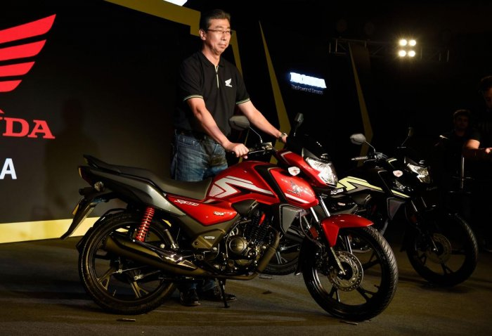 President, CEO and Managing Director, Honda Motorcycle and Scooter India Pvt. Ltd Minoru Kato poses for a photograph with the newly launched BSVI motorcycle (SP 125 BSVI), in New Delhi. PTI