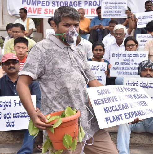 "Members of United Conservation movement, Citizens and Environment lovers campaigning ""Save Western Ghats"" during their protest against Sharavathi underground pumped storage project, Kaiga Nuclear Reactors and Power Line to Goa, in front of Town hall in Bengaluru. (DH Photo)"