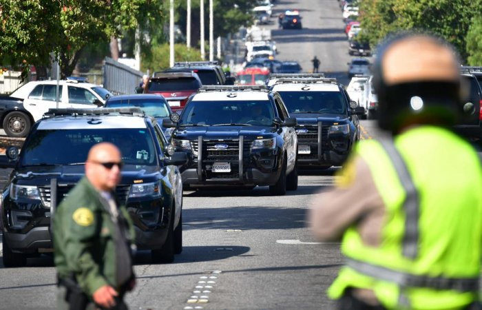 Law enforcement officials are seen outside Saugus High School at Central Park in Santa Clarita, California. (AFP Photo)