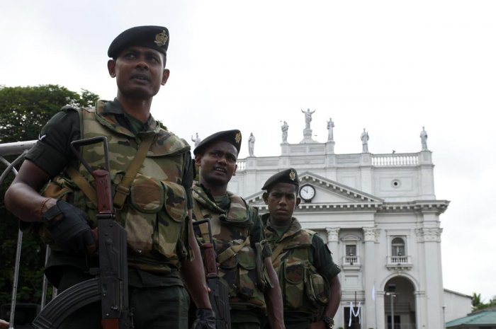 Sri Lankan Army soldiers stand guard at the St Lucia's Cathedral during a holly mass held to bless the victims of Easter Sunday attacks in Colombo. (Photo by AFP)