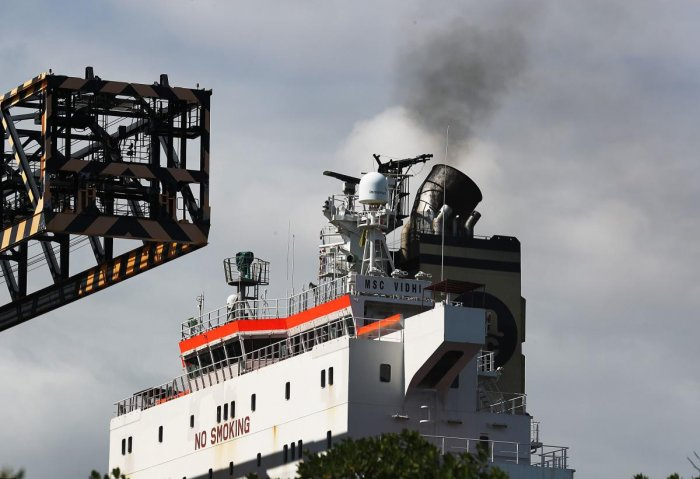 Smoke is seen pouring from the smoke stack on a container ship at Port Everglades. (Photo by AFP)