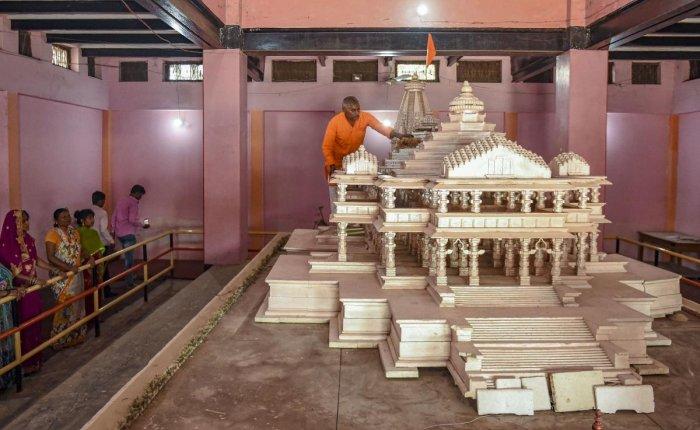 Replica of the proposed Ram Mandir on display at Karsewakpuram, in Ayodhya. (PTI Photo)