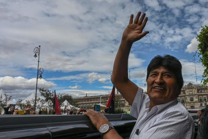 Bolivian ex-President Evo Morales waves as he leaves the Historic City Hall where he was honored as Distinguished Guest by Mexico City's Mayor Claudia Sheinbaum. (Photo by AFP)